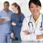 Why do doctors wear scrubs? How did the practice begin?